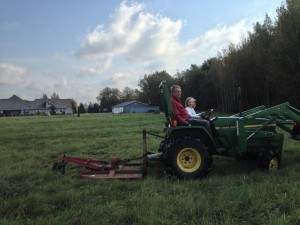 Grandfather and Kid On Tractor