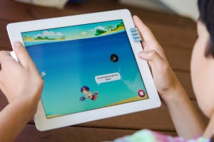 Tynker-iPad-Child-Playing-Tilt-Game