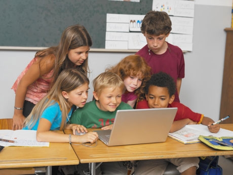 Kids Crowded Around Laptop